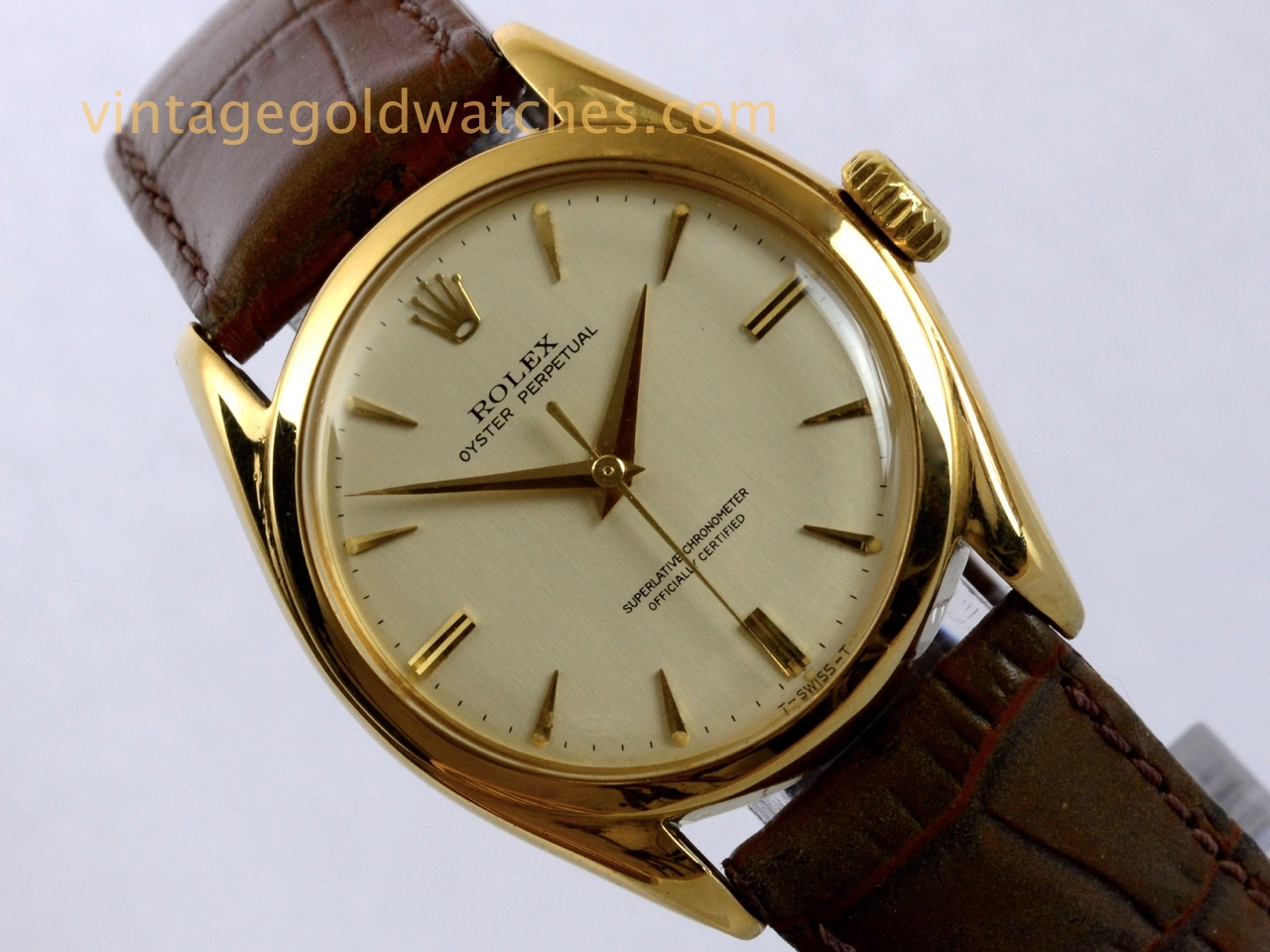 Rolex oyster perpetual 18ct guilloch dial 1953 vintage gold watches for Vintage gold watch
